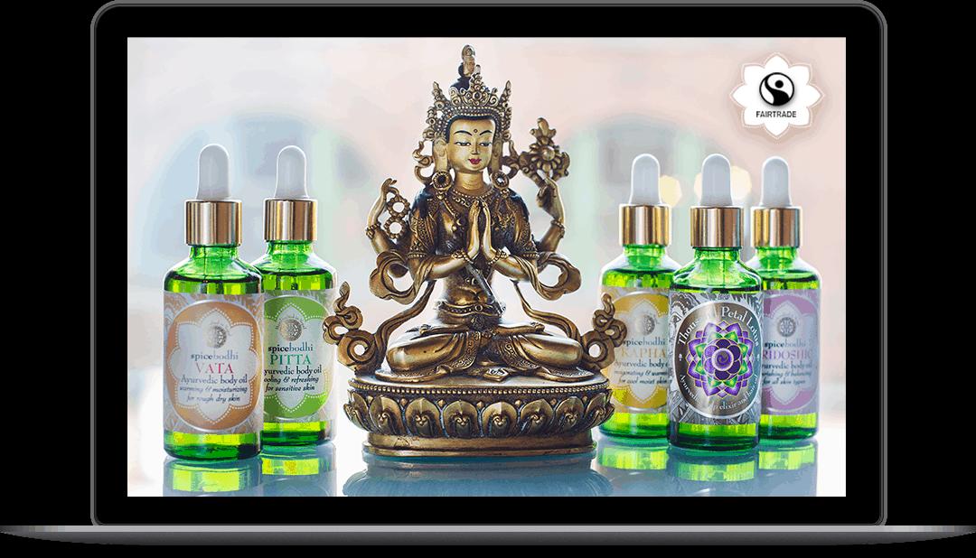 Mystic Masala massage oils on laptop